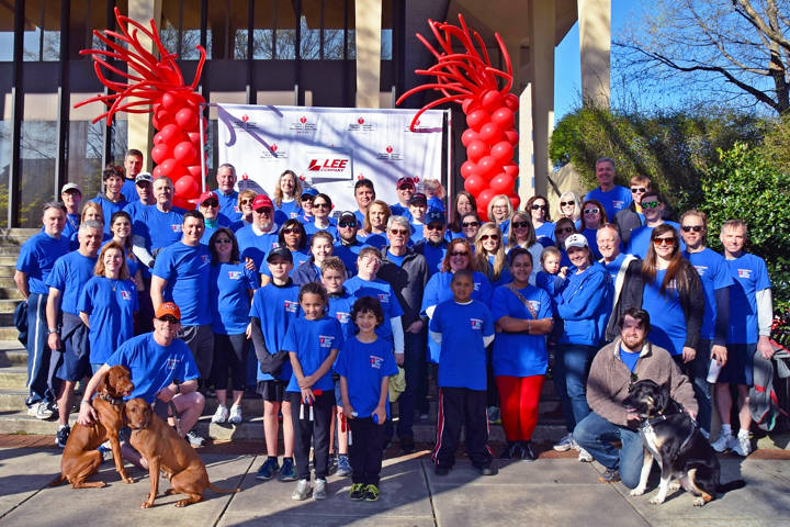 Torch In Action volunteers participate in the American Heart Associate Heart Walk to raise money for heart disease patients and research.