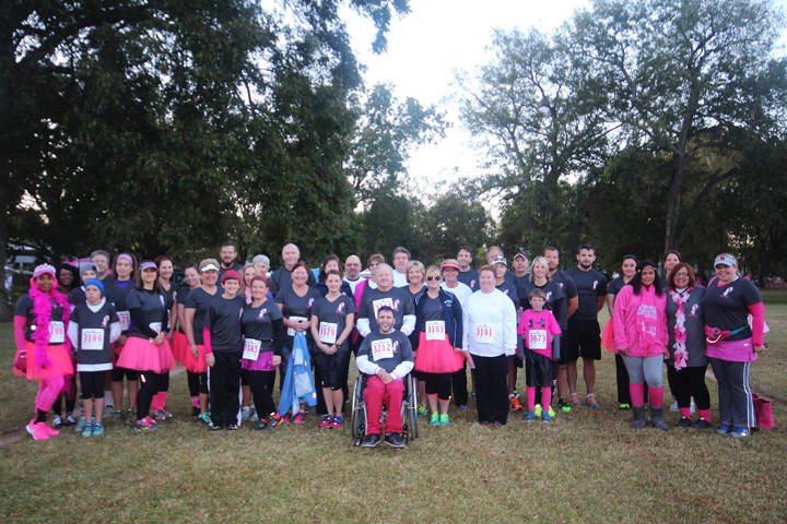 Torch In Action runners participate in the Liz Hurley Ribbon Run to raise money for breast cancer prevention.