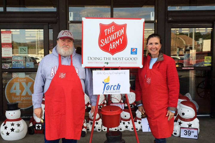 Torch In Action volunteers serving as Salvation Army bell ringers.